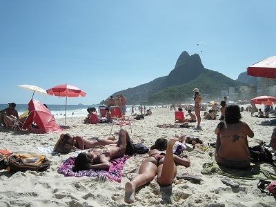 lots of pretty girls on a sandy beach in Copacabana
