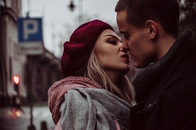 young man and woman looking at each other with love and getting ready to start kissing