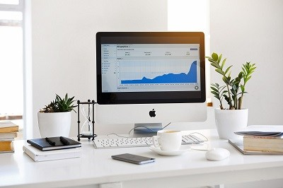 a computer monitor shows content and graph