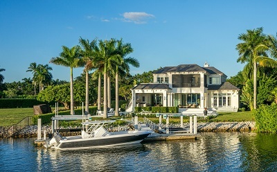 beautiful lakefront home business with wooden steps to access a boat