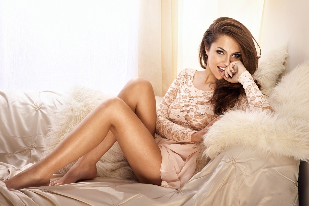 beautiful woman sitting on her bed in her sexy night clothes