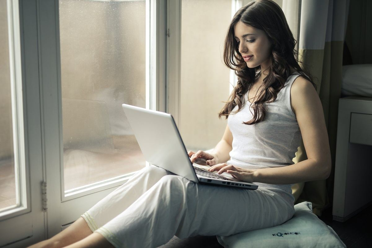 young woman using her laptop computer at her home