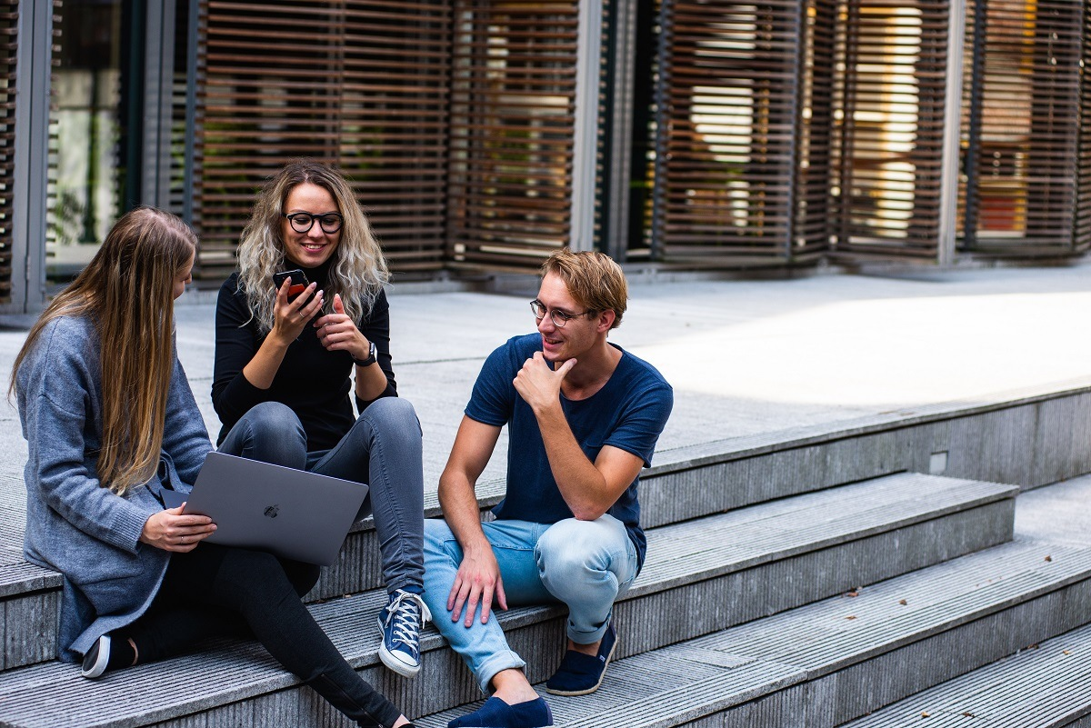 three young entrepreneurs meeting outdoor